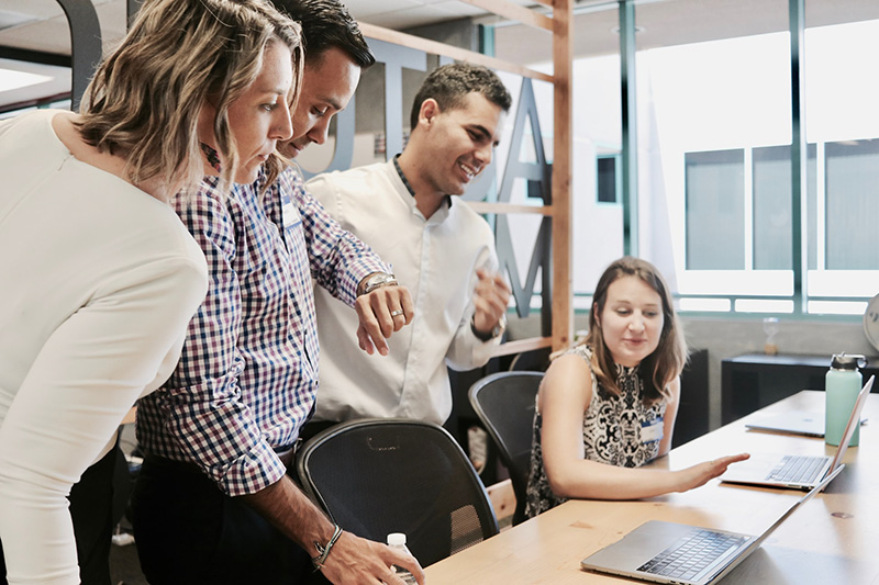 group of employees looking at screen